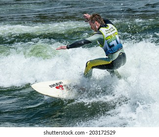 CASCADE, IDAHO/USA - JUNE 21, 2014: Surfer riding a wave during the Payette River Games at Cascade, Idaho