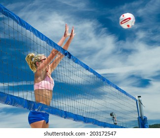CASCADE, IDAHO/USA - JUNE 21, 2014: Unidentified woman jumps at the net to block at the Payette River Games in Cascade, Idaho