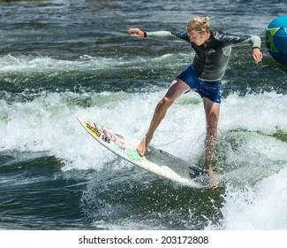 CASCADE, IDAHO/USA - JUNE 21, 2014: Man getting a little air at the Payette River Games in Cascade, Idaho