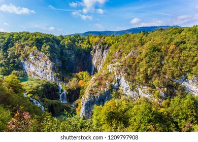 Cascade Plitvice Lakes and huge karst caves. Plitvice Lakes in Croatia on a sunny warm day. The concept of ecological and active tourism