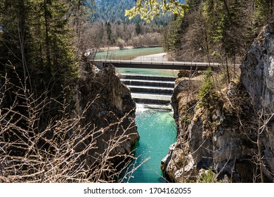 """Cascade of the river """"Lech"""" nearby Fuessen with the five steps and the bridge without people in spring with turquoise water"""