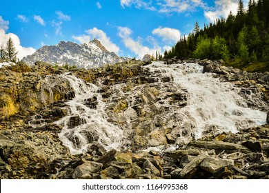 Cascade waterfall at Lake of the Hanging Glacier in the Purcell Mountains, British Columbia, Canada