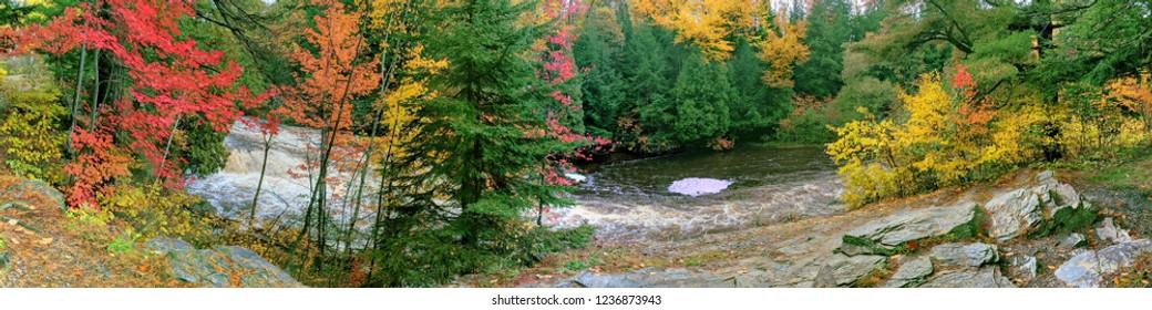 Cascades of the Falls River seen through beautiful autumn colors near L'anse Michigan