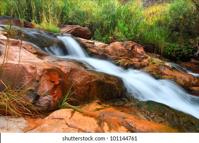 Cascades of a small stream flowing through Grand Canyon National Park on its way to the Colorado River
