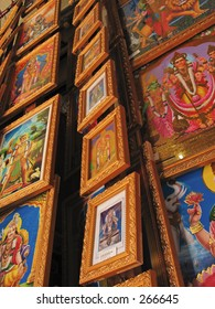 Cascading pictures of Hindu dieties  in gold leafed frames