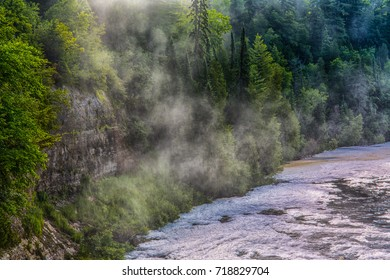Cascading water and mist with rocky cliff