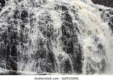 Cascading water over rocks in High Falls, near Superior Lake.