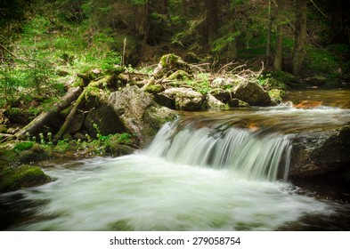 Cascading waterfall in deep forest