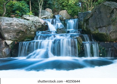 Cascading waterfall with smooth veils of falling water