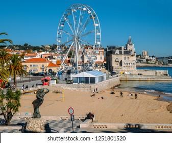 Cascais beach, Lisbon, Portugal - Dec 6, 2018: A giant ferris wheel has been setup at Cascais Beach ahead of the xmas season
