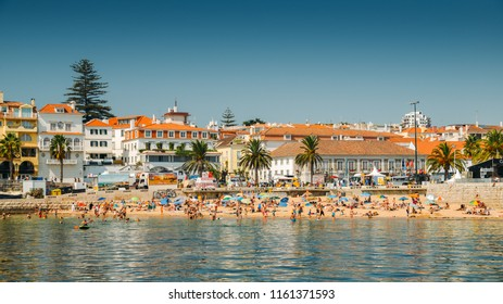 Cascais, Portugal - August 21, 2018: Crowded sandy beach in Cascais near Lisbon, Portugal during the summer. This beach is known as Praia da Ribeira