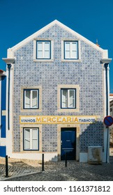 Cascais, Portugal, August 21, 2018: Blue Portuguese style azulejo tiles on an old house in in Cascais, Portugal.