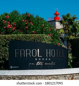 Cascais, Portugal - August 22, 2020: Entrance to luxurious Farol Hotel in Cascais, Portugal with Santa Marta Lighthouse in the background