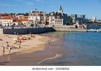 CASCAIS, PORTUGAL - JUNE 13: People sunbathing on the Praia da Rainha beach on June 13,2013 in Cascais, Portugal. Cascais is famous and popular summer vacation spot for Portuguese and foreign tourists