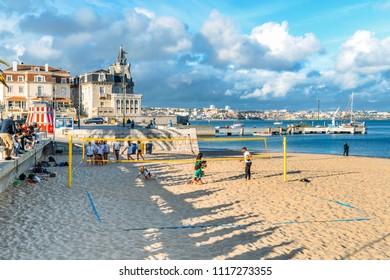 Cascais, Portugal - June 4, 2018: Seaside cityscape of Praia da Ribeira, Cascais. Intimate beach near the train station and popular with tourists