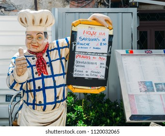 Cascais, Portugal June 5, 2018: Depiction of a chef giving his thumbs up promoting a menu with typical Portuguese food, Cascais, Portugal