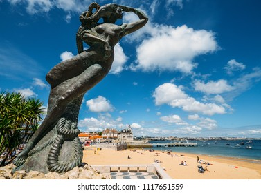 Cascais, Portugal - June 8, 2018: Close up of a mermaid statue looking out into the Atlantic sea at Praia da Ribeira, Cascais, Portugal