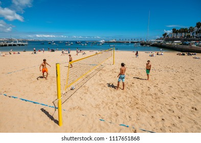 Cascais, Portugal - June 8, 2018: Kids play beach volleyball at Praia da Ribeira, an intimate beach near the train station and popular with tourists