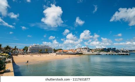 Cascais, Portugal - June 8, 2018: Seaside cityscape of Praia da Ribeira, Cascais. Intimate beach near the train station and popular with tourists