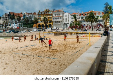 Cascais, Portugal - June 9th, 2018: Men play variation between beach volley and beach football known as Futevolei on a beach in Cascais, Portugal. This sport was invented in Ipanema, Rio de Janeiro