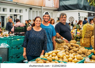 Cascais, Portugal - June 9th, 2018: Illustrative editorial of friendly family of market vendors at Cascais's food market