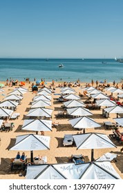 Cascais, Portugal - May 14, 2019: High perspective of crowded sandy beach in Cascais near Lisbon, Portugal in the Costa Verde. This beach is known as Praia da Conceicao