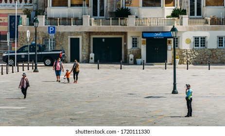 Cascais, Portugal - May 2, 2020: Police officer on vigilance to respect social distancing during the Coronavirus Covid-19 epidemic in Portugal
