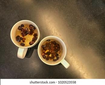 Cascara tea (Sun-dried peel coffee beans tea) in a white cup.