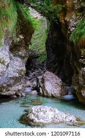 The Cascata della Soffia situated in the heart of Dolomiti Bellunesi National Park, Belluno, Veneto, Italy. Beautiful spot in nature. The Lago del Mis - lake in Veneto.