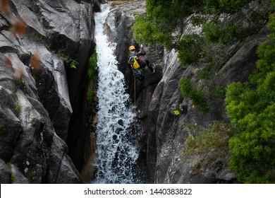 Cascata do Arado, Vilar da Veiga, Portugal - June 10, 2019: One man rappelling the Arado Waterfall (cascata do arado) in the Peneda Geres National Park, in Portugal.