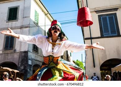 """CASCINA ITALY - JUNE 2017  Stilt walking women in costume at the """"Aspettando la Battaglia di Cascina"""" festival"""