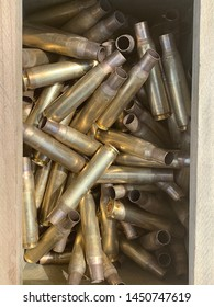Case of 50 caliber bullets casings inside the wooden storage box.