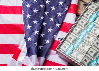 Case with bundles of dollars. American flag laying beside money. Prosperity of business. Financial freedom as it is.