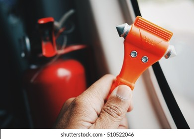 In case of emergency, car, train, monorail and airplane safety red hammers to break the window. - Shutterstock ID 510522046