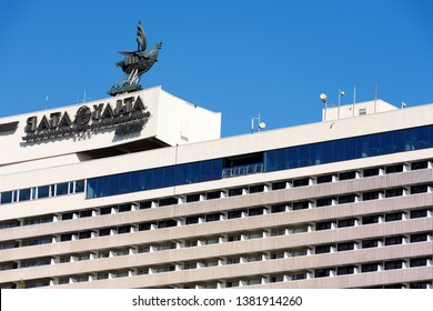 """The case of the hotel resembles an ocean liner, topped with a light boat of ancient navigators. The hotel complex """"Yalta-Intourist"""" was built in 1977. October 2018"""
