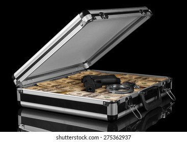 Case with money and gun on black background