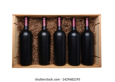 Case of Red Wine: Top view of a wood case of red wine bottles the case is filled with packing straw, isolated on white.