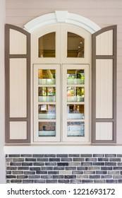 Casement windows with arched frame on top. It is designed in vintage European styles.