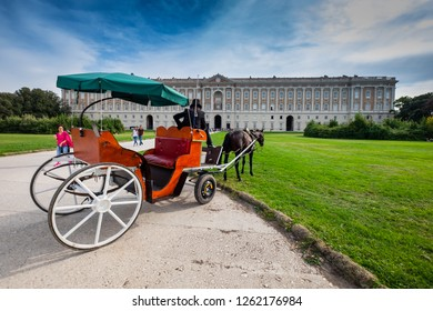 CASERTA, ITALY - SEPTEMBER 24, 2017: horse carriages pass in the garden of Royal Palace of Caserta. Built by the architect Vanvitelli, the historic owners were the Bourbon of Naples.