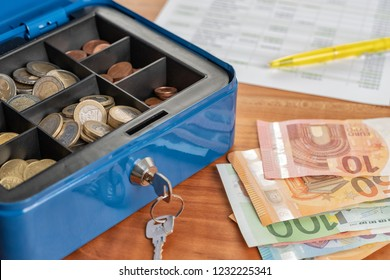 A cash box with euro banknotes and coins