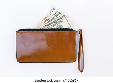 Cash in brown lady purse on white background