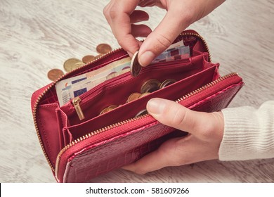 Cash counting. Money in the red wallet. Euro coins.
