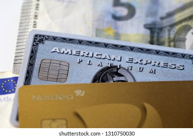 Cash and credit cards. There is American Express (Amex) Platinum, MasterCard  Gold and 5 euro note. Symbols of finance and wealth. Photographed in Kuopio, Finland during February 2019.