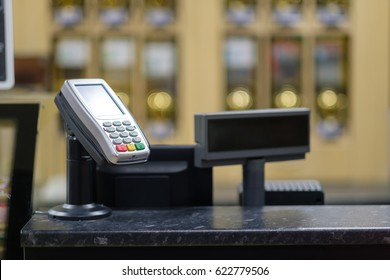 Cash desk with card payment terminal and information screen in small cafe