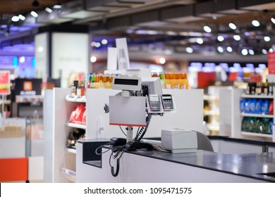 Cash desk with card payment terminals on blurry background