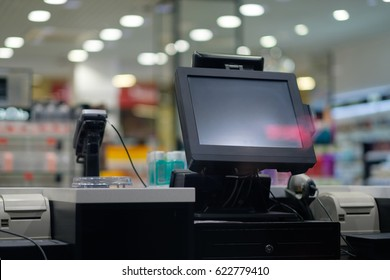 Cash desk with large screen and card payment terminal in modern store