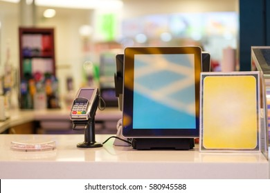 Cash desk with order screen and card payment terminal in small cafe