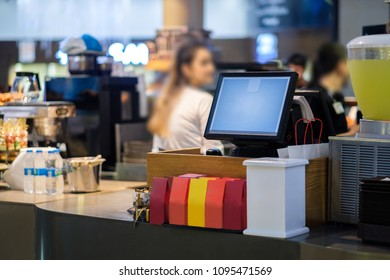 Cash desk terminal with order screen in small cafe
