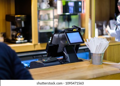 Cash desk terminal with screen in small cafe