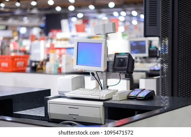 Cash desks with card payment terminals on blurry background